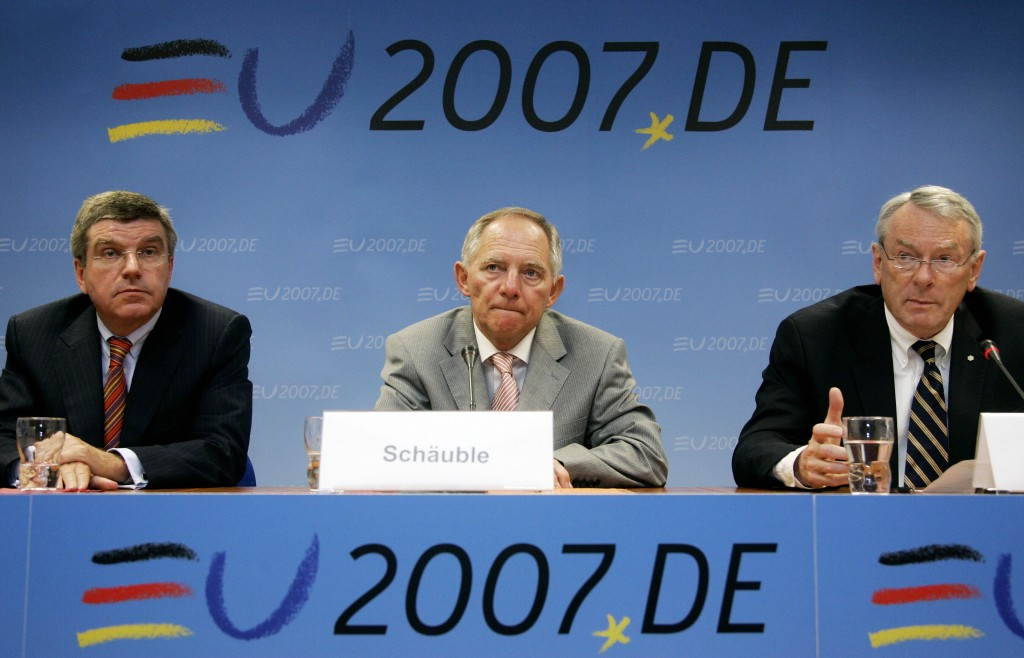 Richard Pound, speaking, right, alongside Thomas Bach, left, during a press conference in 2007, is an opponent of the Youth Olympic Games, which he does not believe encourages more sporting activity ©Getty Images
