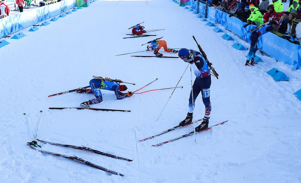 The biathletes collapsed with exhaustion following the conclusion of the mixed team relay event ©YIS/IOC