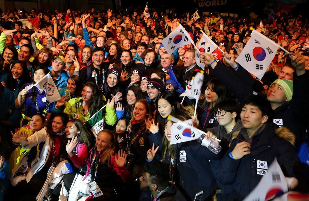 A group photo with Bach and some of the athletes was taken during the party-style Ceremony ©YIS/IOC