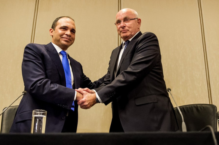 Prince Ali Bin Al-Hussein (left) and Michael van Praag (right) show a sign of unity in Amsterdam this evening