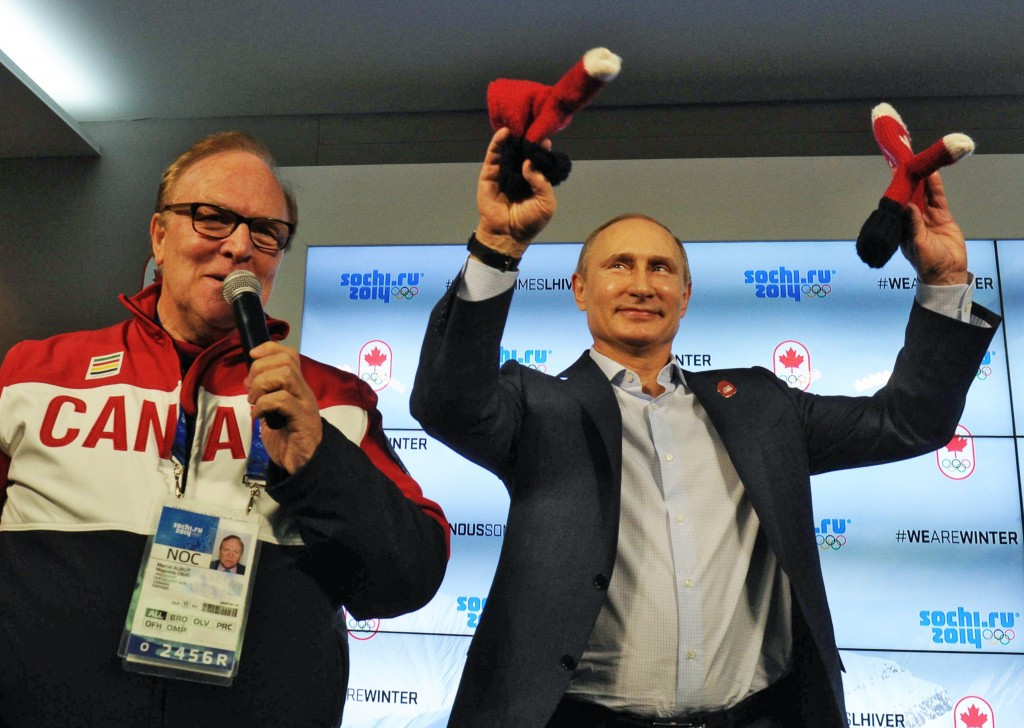 Former Canadian Olympic Committee President Marcel Aubut (left), pictured with Russian President Vladimir Putin during the Sochi 2014 Olympic Games ©Getty Images