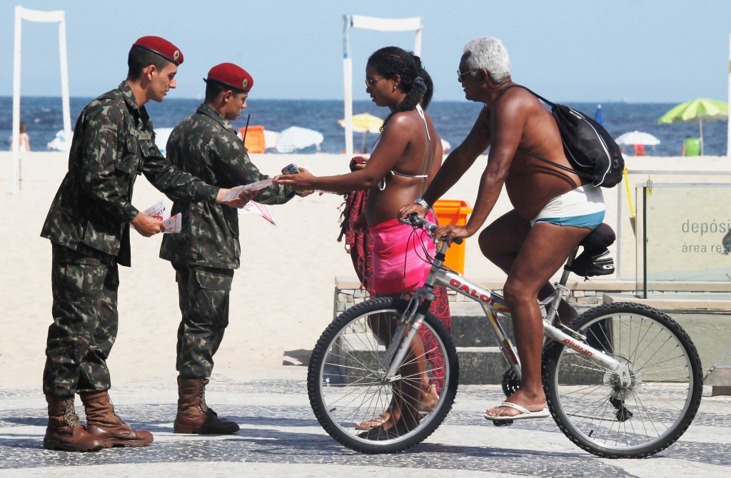 Army officers hand out advice on Zika on Rio's famous Copacabana Beach