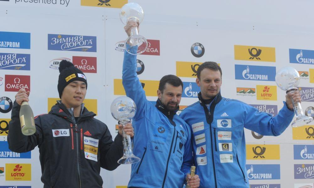 Martins Dukurs (centre) celebrates victory in the men's skeleton World Cup ©FIBT