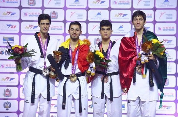 Jaouad Achab (second left) was wrapped in the Belgium despite winning under 63kg gold as an independent athlete at last week's World Championships ©WTF