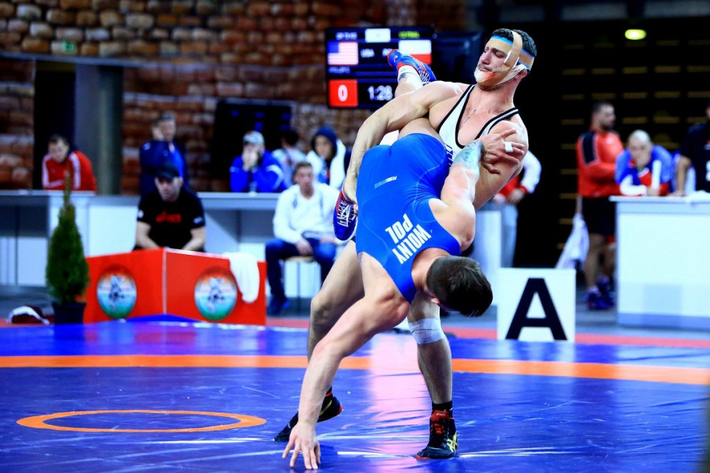 The United States won three gold medals in Greco-Roman wrestling to top the team standings