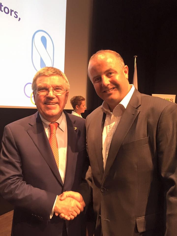 Pierce O'Callaghan with International Olympic Committee President Thomas Bach ©Facebook