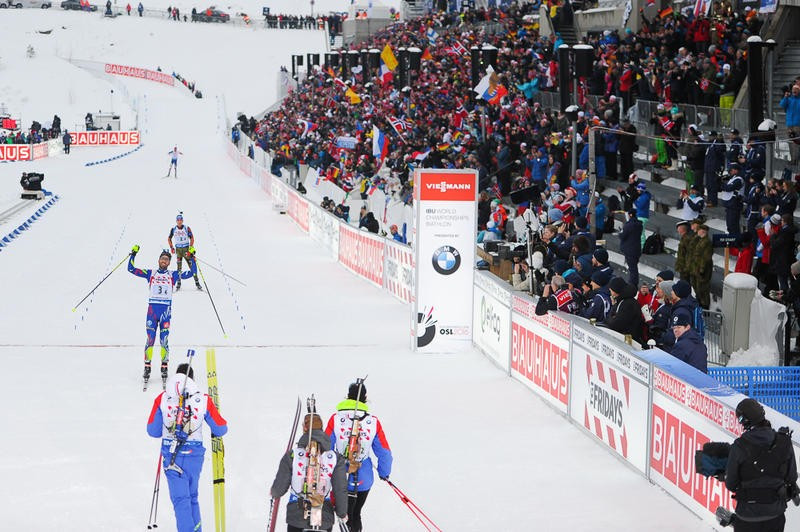 Martin Fourcade held off German rival Simon Schempp in the final leg to secure the title