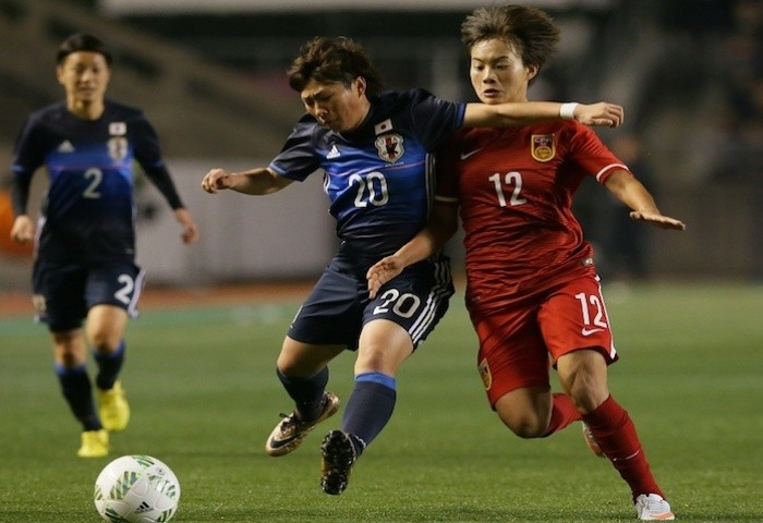 China beat Japan 2-1 to move onto seven points