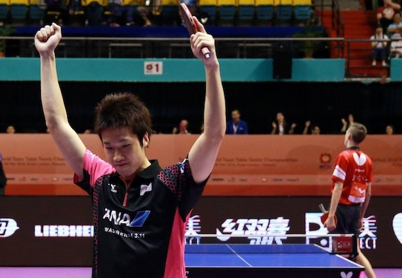 Jun Mizutani celebrates after putting Japan into the ITTF World Team Championships final ©ITTF