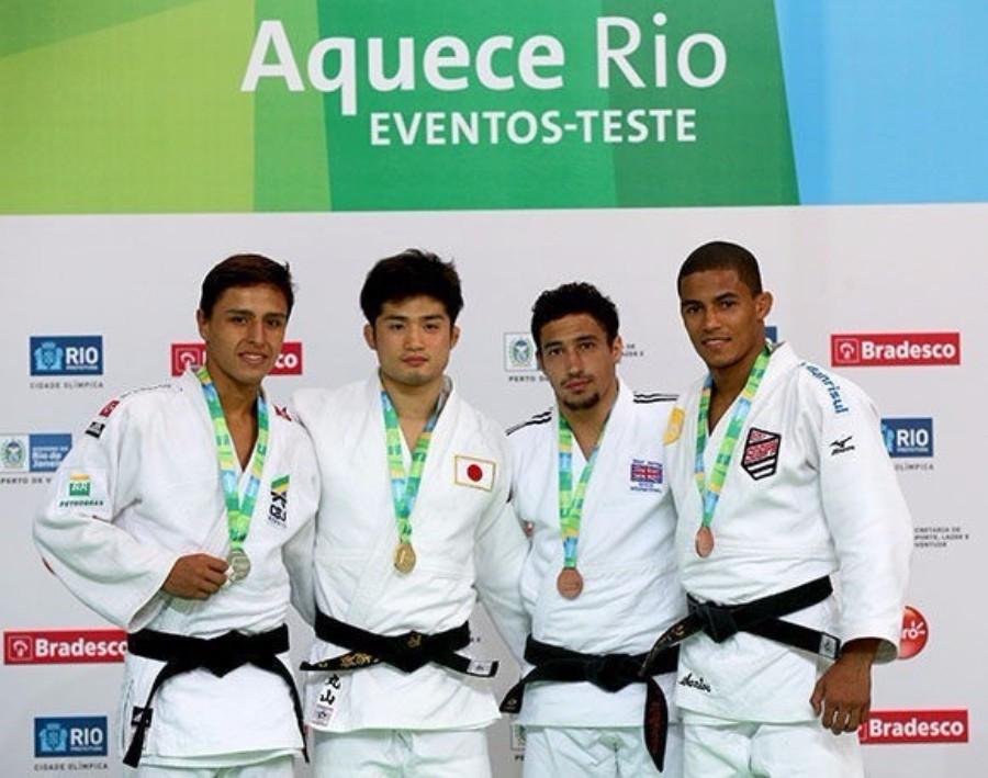 japan's Joshiro Maruyama (second left) claimed the men's under 66kg title ©IJF