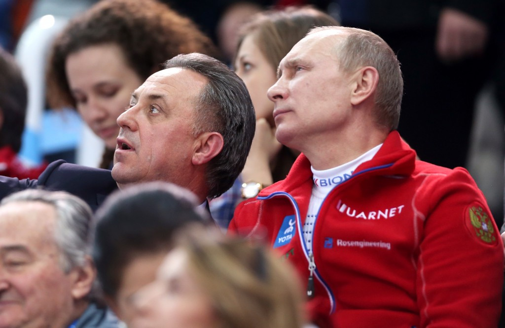 Vitaly Mutko (centre left) pictured with Vladimir Putin, has accepted full responsibility ©Getty Images