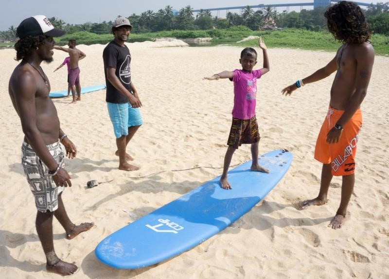 instructors teaching children on an ISA educational course ©Surfing Federation of India