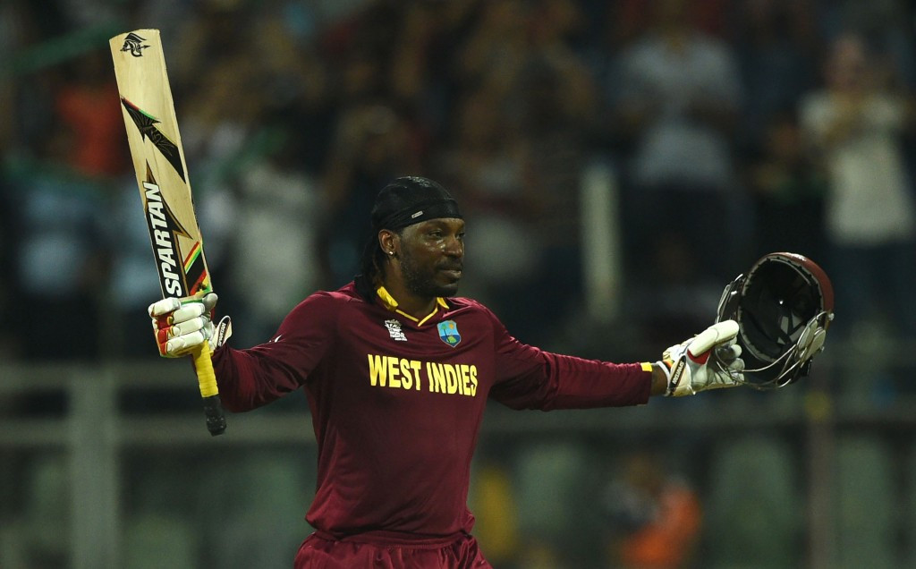 Chris Gayle celebrates reaching three figures against England today ©Getty Images