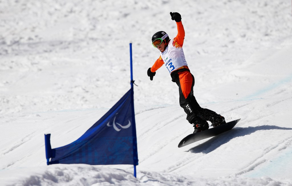 Chris Vos, pictured at Sochi 2014, followed his banked slalom victory yesterday with a snowboard cross success today ©Getty Images