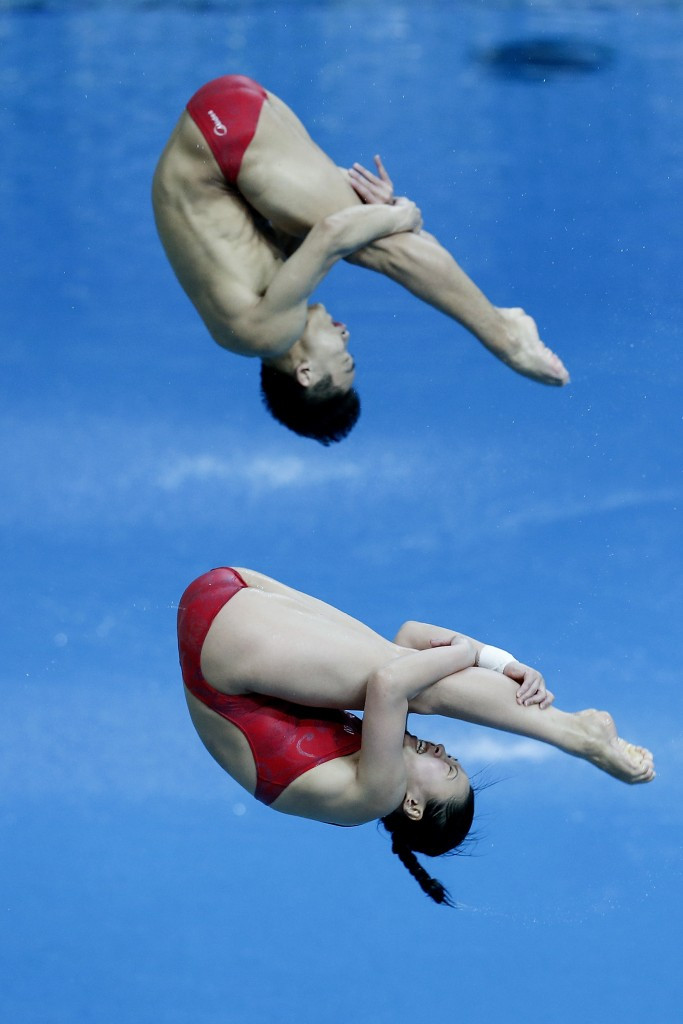 Yang Hao and Wang Han won mixed-synchro gold on the final day of competition