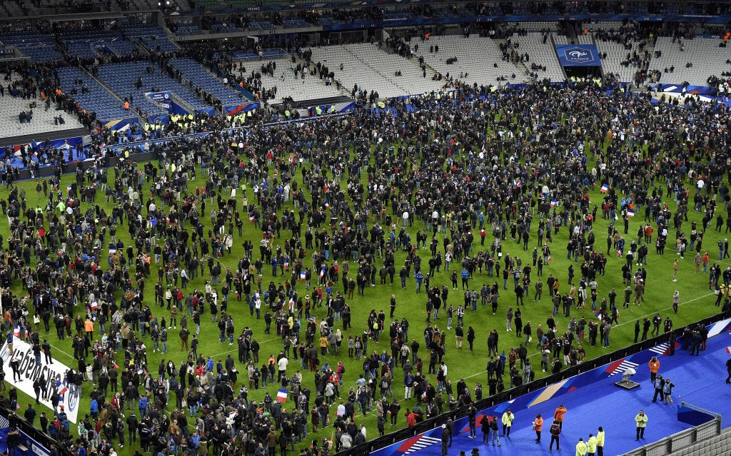Fans spill onto the pitch following the attacks in Paris last November, which targeted the Stade de France ©Getty Images