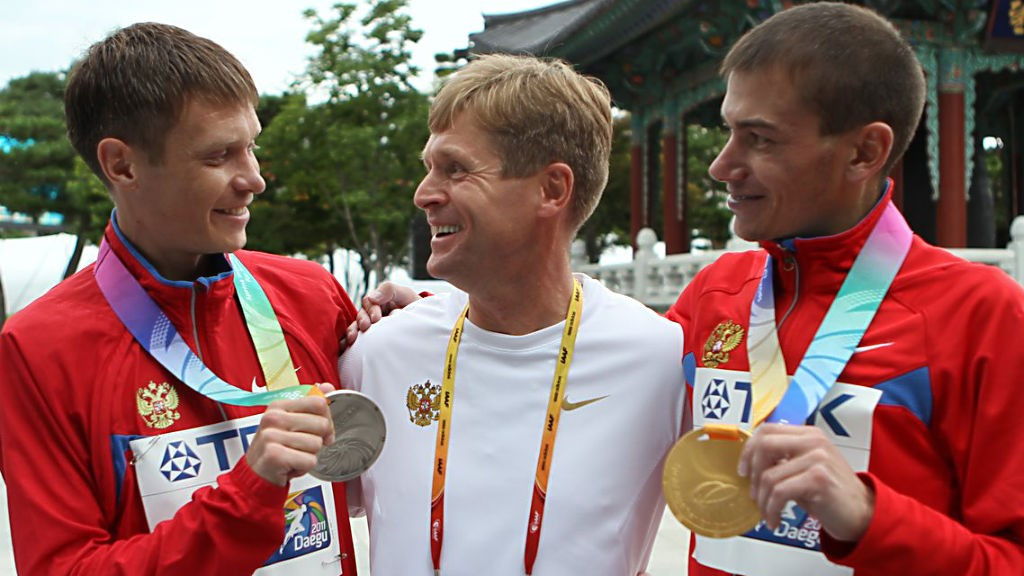 Viktor Chegin, centre, has worked with almost all of the Russia's drug tainted race-walking team in recent decades ©Getty Images
