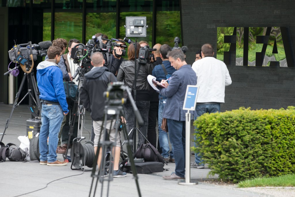 Journalists, photographers and TV crews queue to enter the FIFA headquarters