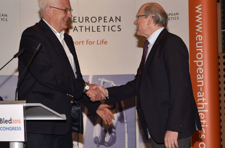 Svein Arne Hansen is congratulated on being elected European Athleics President by Hansjörg Wirz, who had held the post for 16 years
