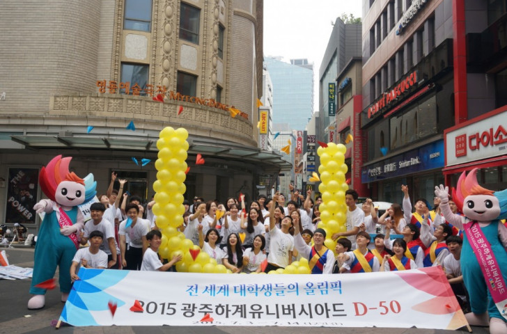 Gwangju 2015 supporters promoting the Summer Universiade in Seoul's shopping mecca, Myeongdong