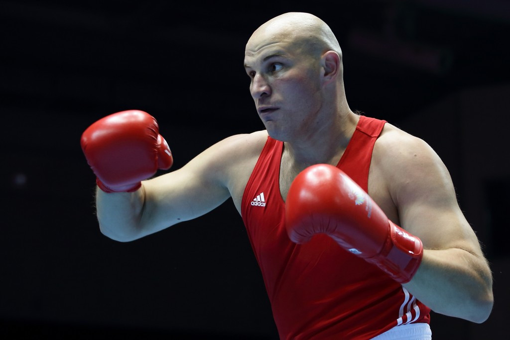 Kazakhstan's Ivan Dychko justified his billing as the top seed in the super heavyweight division by ousting Bakhodir Jalolov of Uzbekistan