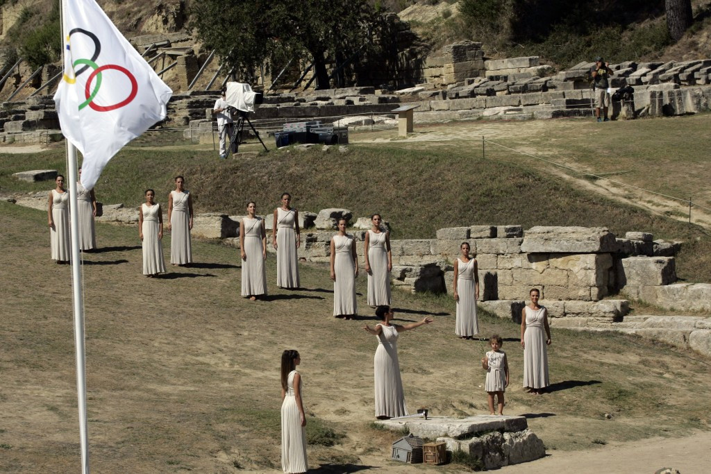 The Sochi 2014 Olympic Flame being lit by the rays of the sun in the Temple of Hera ©Getty Images
