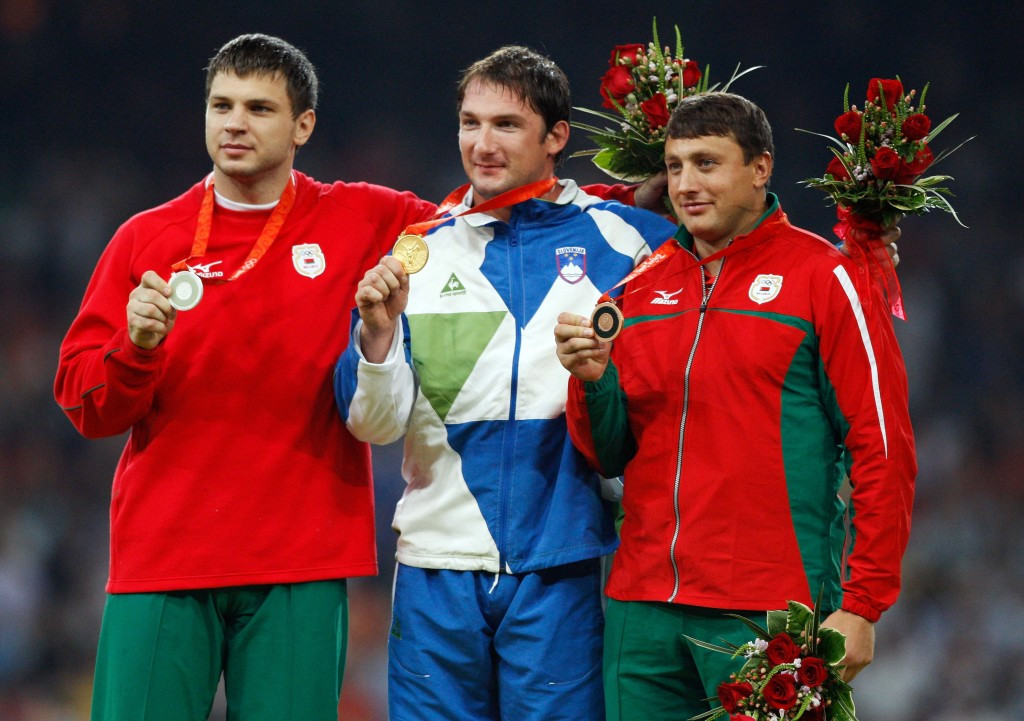Belarus' Vadim Devyatovskiy celebrates the Olympic silver medal he won at Beijing in 2008 and which he was stripped of briefly before it was returned to him ©Getty Images