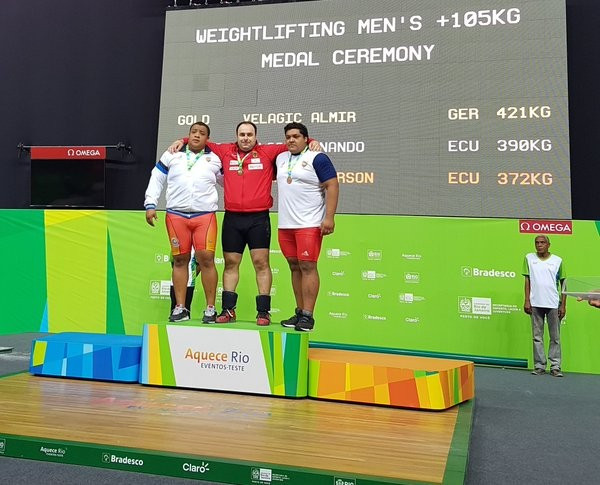 Almir Velagić (centre) claimed German gold in the men's heavyweight division ©Twitter/Attila Adamfi