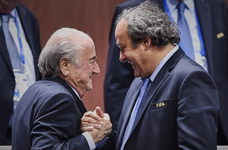 Sepp Blatter is congratulated by UEFA head Michel Platini following his election victory ©AFP/Getty Images