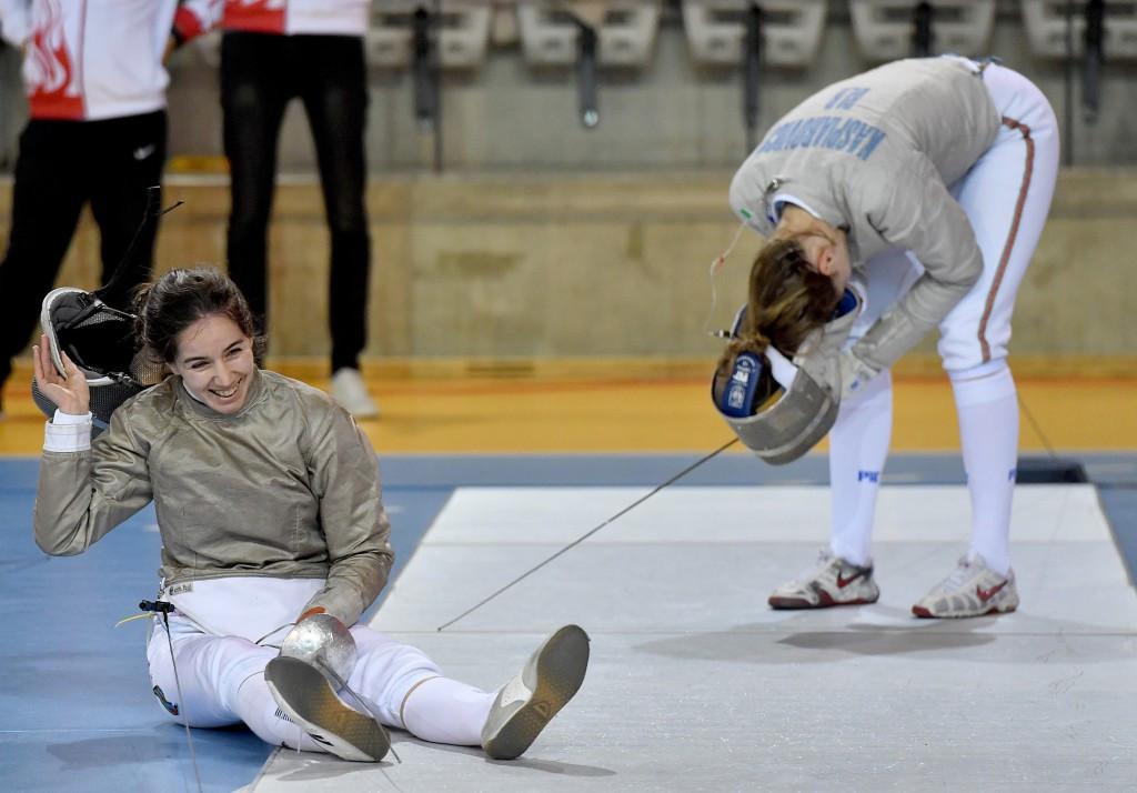 Azerbaijan's Sabina Mikina celebrates winning the women's individual sabre title at the European Olympic qualifying event