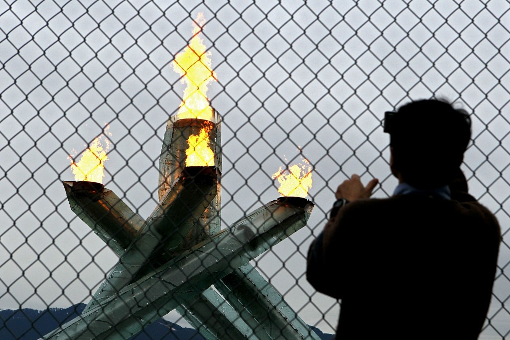 There was criticism that Vancouver 2010 kept the Olympic flame behind a wire fence ©Getty Images