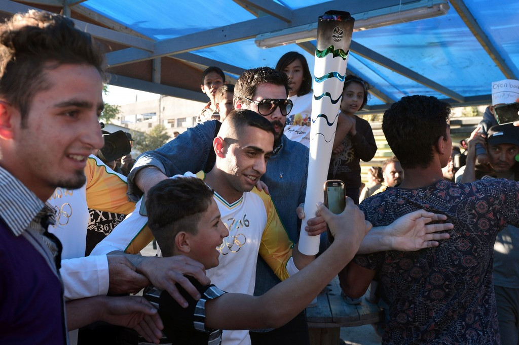 Ibrahim Al Hussein was mobbed by fellow refugees on his short journey with the Olympic Torch ©Getty Images