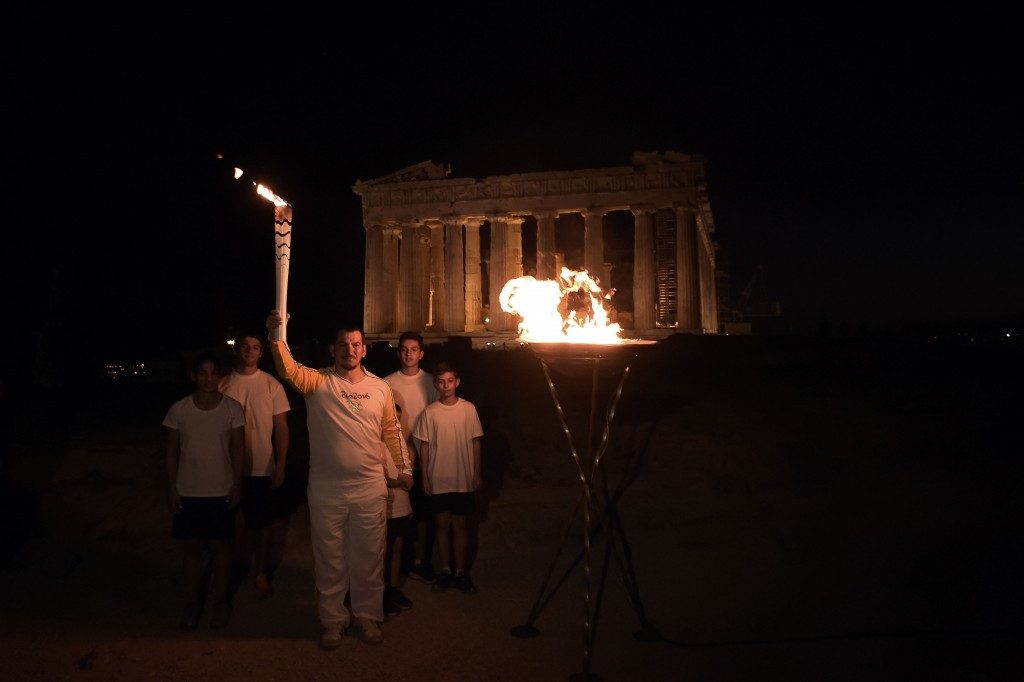 The Olympic flame is spending the evening at the Acropolis Museum after visiting the Eleonas Reception Centre ©Getty Images