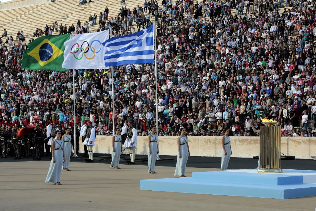 The Brazilian, Olympic and Greek flags fly over the Panathinaiko Stadium in Athens during the Handover Ceremony of the flame to Rio 2016 ©Getty Images