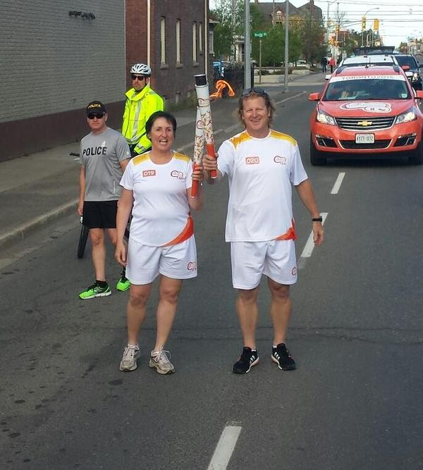 Curt Harnett, Chef de Mission of the Canadian Pan American Games team, was one of the latest Torchbearers