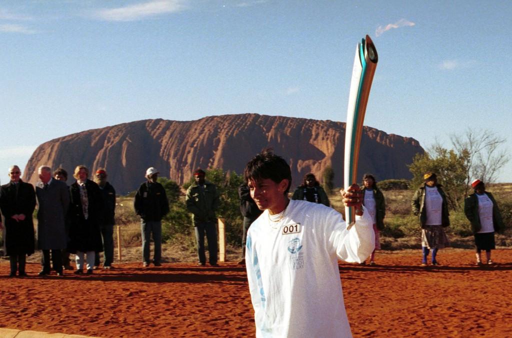 Nova Peris Kneebone began the Sydney 2000 torch relay at Uluru