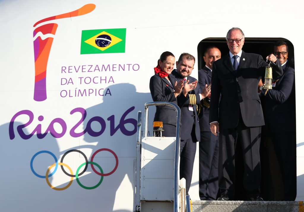 Rio 2016 President Carlos Nuzman steps off the plane in Brasilia with the Olympic flame ©Getty Images