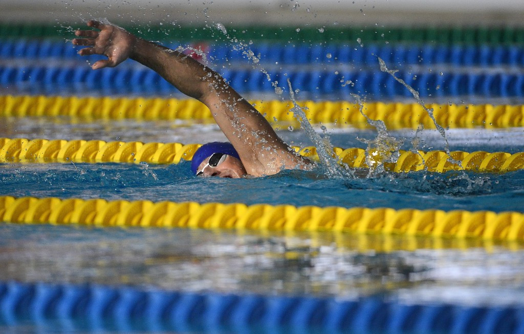 Ukraine's Dmytro Vynohradets recovered from a poor start to win the men's 150m individual medley SM3