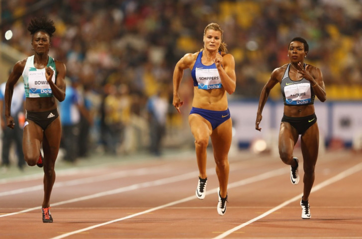Dafne Schippers of the Netherlands (centre) had to settle for second in the Doha 100m despite running 10.83 as Tori Bowie of the United States (left) clocked 10.80 ©Getty Images