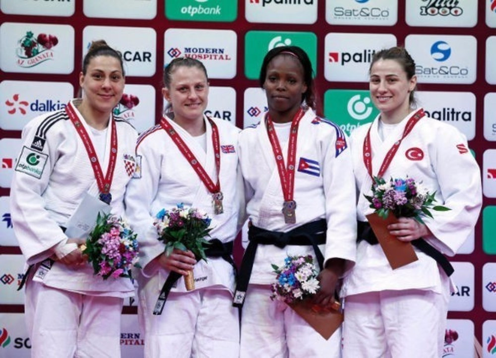 Britain's Alice Schlesinger won all five of her contests by ippon in the women's under 63kg event
