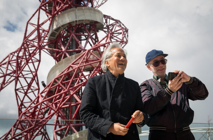 Anish Kapoor (left) and Carsten Holler in front of the ArcelorMittel Orbit which they jointly designed, and which now has the