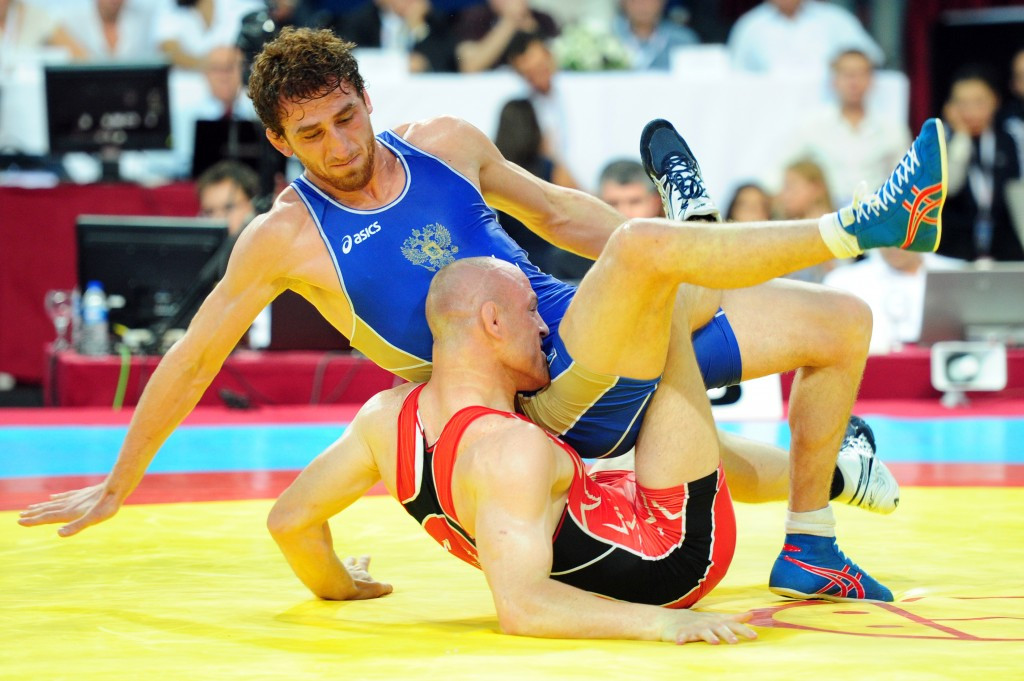 Albert Saritov, in blue fighting for Russia earlier in his career, was among winners today ©AFP/Getty Images