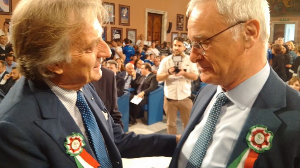 Claudio Ranieri (right) meets with Rome 2024 President Luca di Montezemolo while wearing a rosette featuring the bid logo