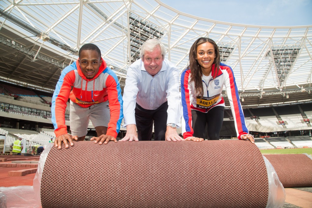 CJ Ujah (left) and Adelle Tracey (right) were joined by Brendan Foster to lay the sections of the track ©Great Newham London Run
