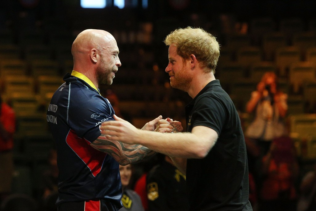 Prince Harry presents powerlifter with Britain's first gold medal of 2016 Invictus Games