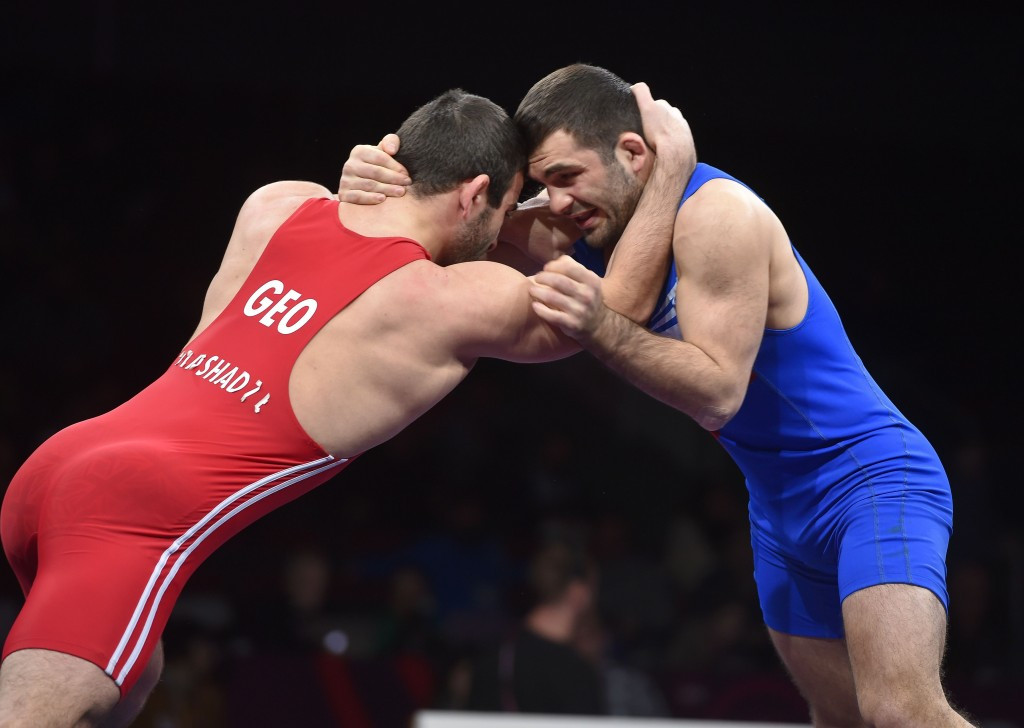 Poland's Magomedmurad Gadzhiev (right) has lost his Olympic licence in the men's freestyle 65kg category
