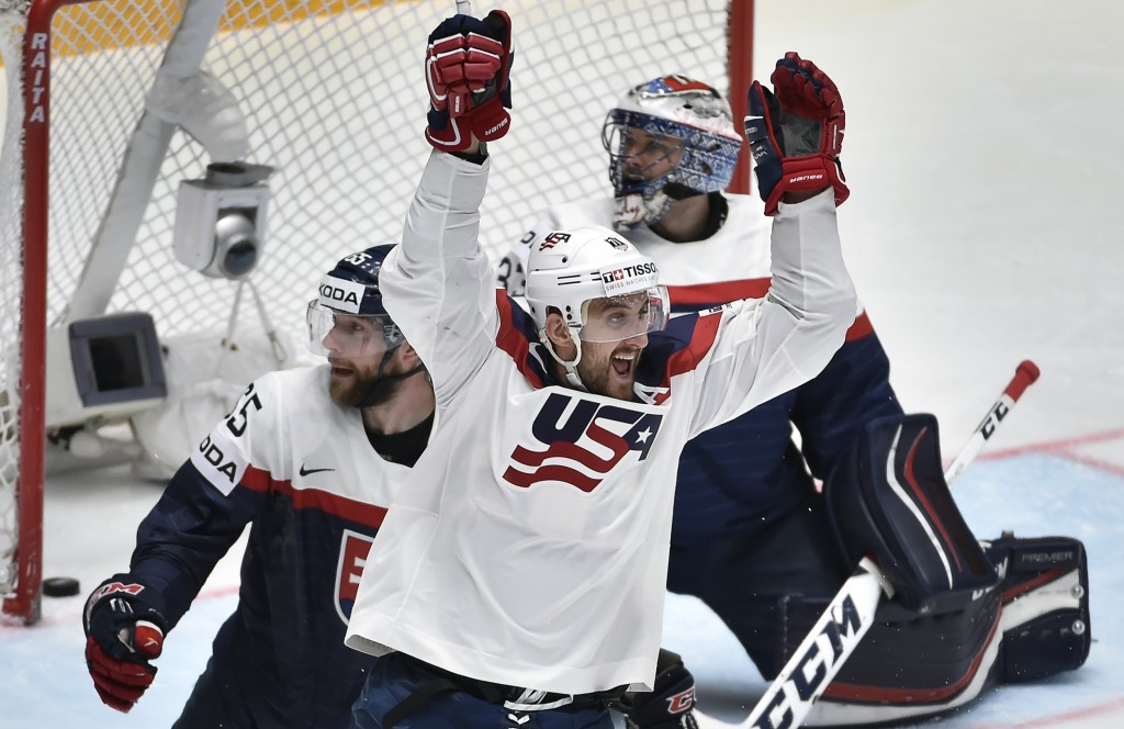 United States reach IIHF World Championship quarter-finals despite overtime loss as Finland shock Canada
