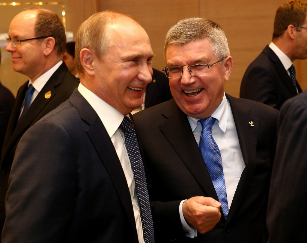 Thomas Bach, right, has ties with Russian President Vladimir Putin  ©Getty Images