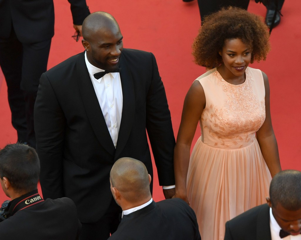 Teddy Riner and his partner Luthna arrive at the Cannes Film Festival ©Getty Images