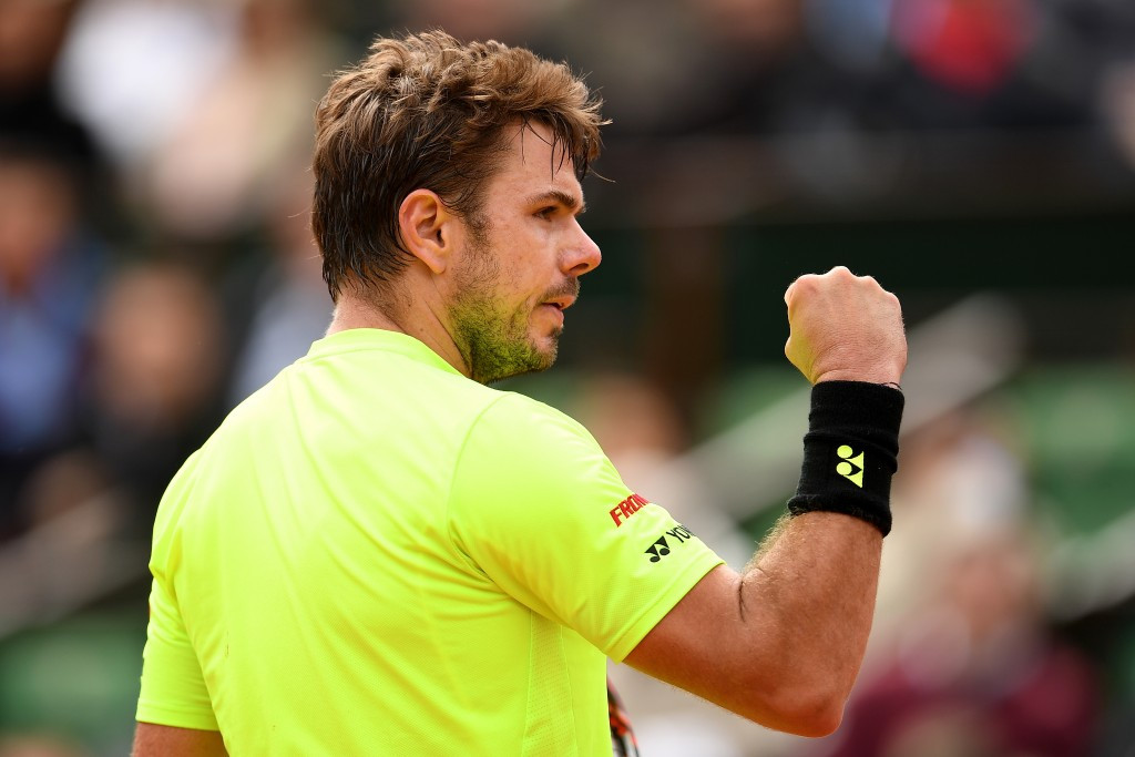 Wawrinka battles to victory to begin defence of French Open singles title